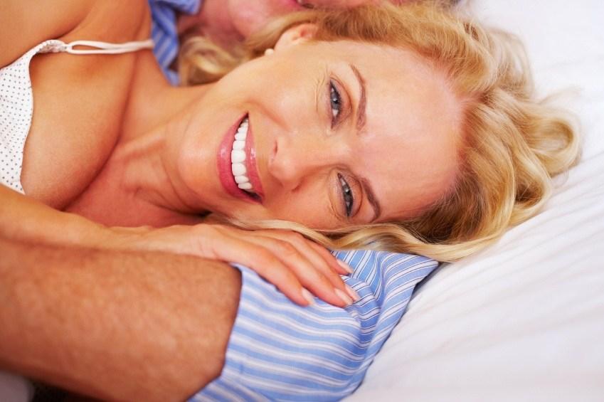 Woman lying down, smiling